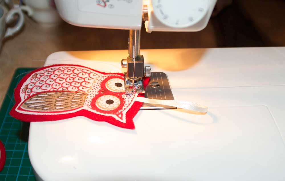machine sewing the owl decorations