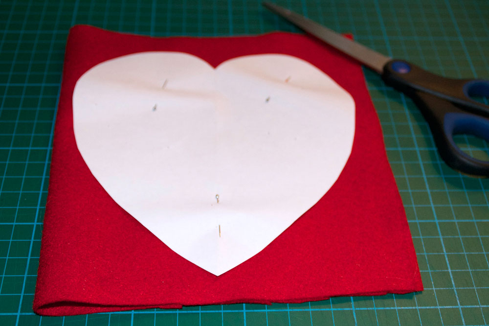 felt material ready to cut out the heart pattern